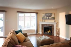 Ascent B36 in a living room with mantel