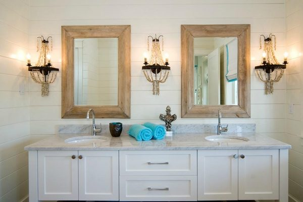 bathroom-with-wood-framed-mirrors-and-shell-sconce-lighting-at-the-beach-with-kris